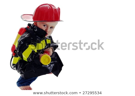 A boy pretending to be a firefighter Stock photo © IS2
