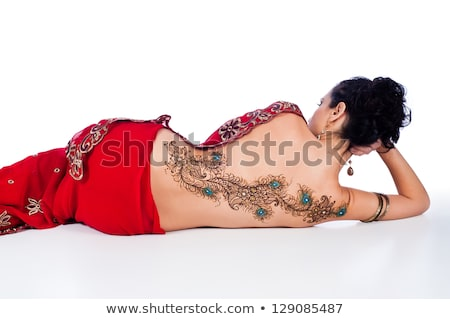 Rear view of a woman with tattoos Stock photo © IS2