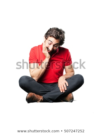 young businessman sits on chair and looks down to side Stock photo © feedough