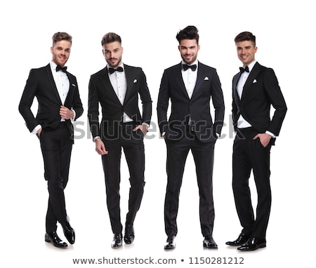 elegant man in tuxedo standing with hands and leg crossed  Stock photo © feedough