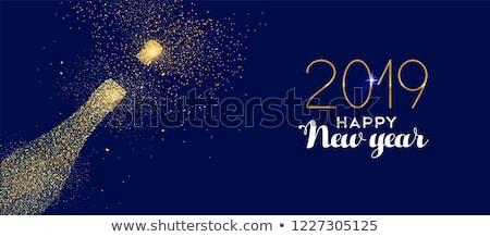 Nouvelle année bleu glitter champagne bouteille carte Photo stock © cienpies