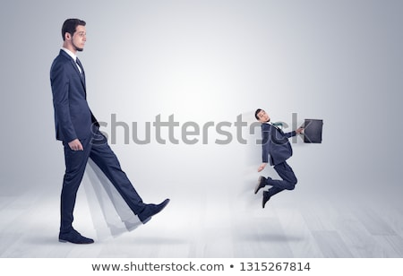 Stock photo: Small man fired by boss with white wallpaper