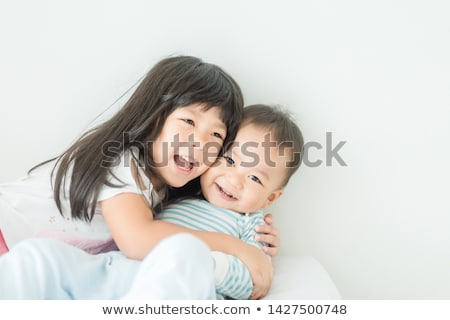 брат сестра расслабляющая вместе кровать семьи Сток-фото © Lopolo