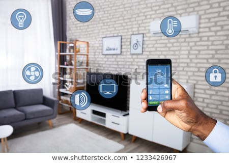 persons using smart home system application stock photo © andreypopov