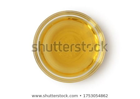 Apple cider vinegar in a glass bowl, with an apple in the background Stock photo © madeleine_steinbach