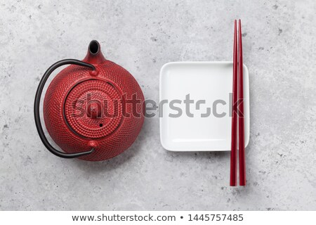 Empty plate, cup, teapot and chopsticks Foto d'archivio © karandaev