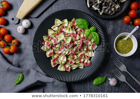 portion of farfalle with pesto with ingredients stock photo © alex9500