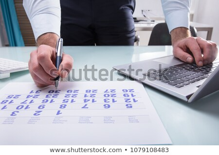 Businessperson Using Calendar On Laptop Stock photo © AndreyPopov