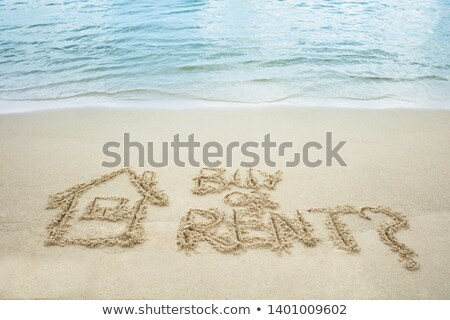 Buy Or Rent Text With Drawn House On Sand Stock photo © AndreyPopov