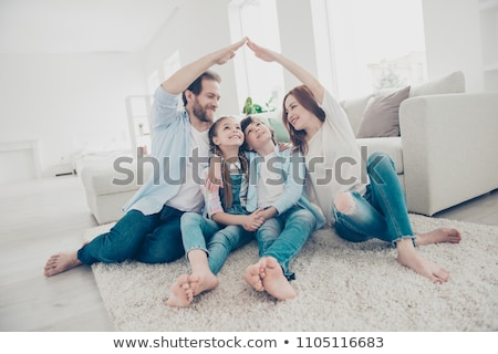 couple protecting family figures with roof stock photo © andreypopov