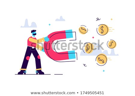 Man attracting coins with a big magnet.  stock photo © sgursozlu