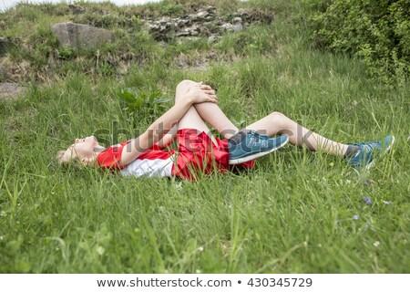 Atletisch jongen pijnlijk gewond knie Stockfoto © Lopolo
