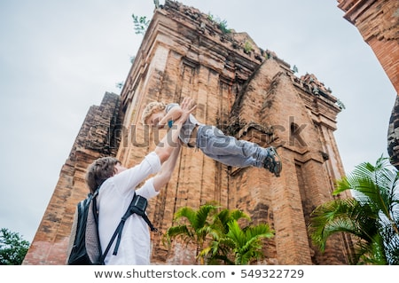 Father and Toddler Son tourists in Vietnam. Dad throws up his . Po Nagar Cham Tovers. Asia Travel co Stock photo © galitskaya