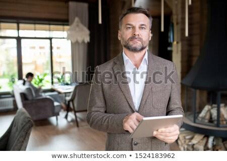 Sérieux âge moyen affaires barbe touchpad restaurant Photo stock © pressmaster