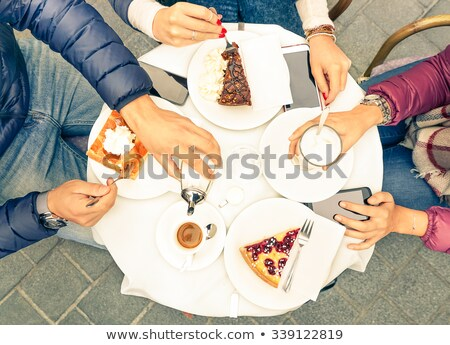 Top view on people, drinks, and food in a fancy restaurant Stock photo © Kzenon