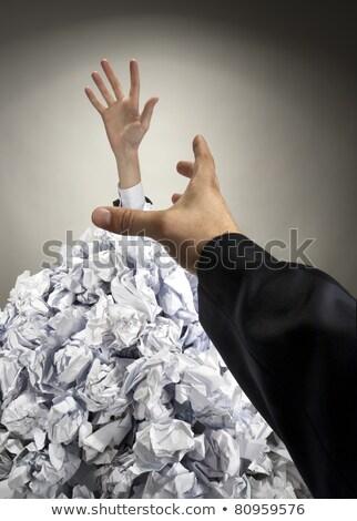Zakenman zinken groot hoop papieren vragen Stockfoto © nomadsoul1