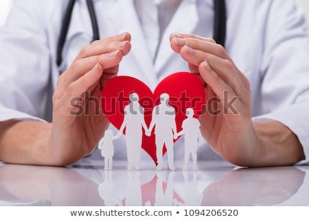 Orvos család kivágás szív alak közelkép orvosok Stock fotó © AndreyPopov