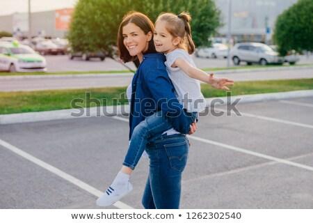 Fotografia szczęśliwy brunetka kobieta denim ubrania Zdjęcia stock © vkstudio