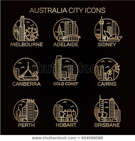 Perth City skyline golden silhouette. Stock photo © ShustrikS
