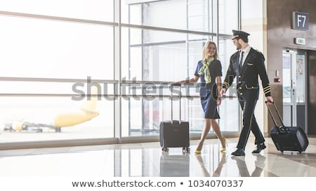 beautiful stewardess at the airport Stock photo © smeagorl