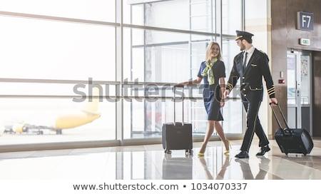 beautiful stewardess at the airport Stock photo © smeagorl