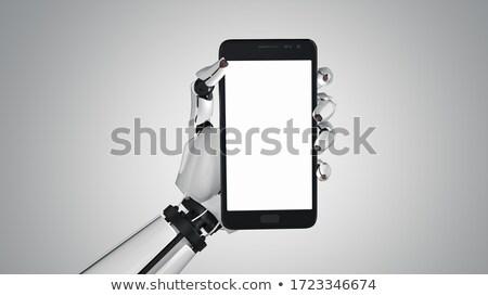 гуманоид робота стороны смартфон белый экране Сток-фото © limbi007