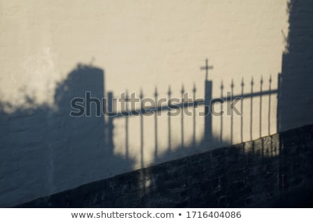 Shadow of a Gate with a Cross in it Stock photo © Qingwa