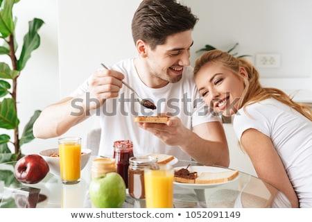 portret · para · śniadanie · kobieta · domu · zabawy - zdjęcia stock © photography33
