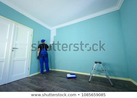 Homem pintura quarto homem branco branco parede Foto stock © photography33