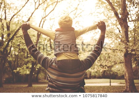 man carrying little girl on his back in a meadow stock photo © photography33