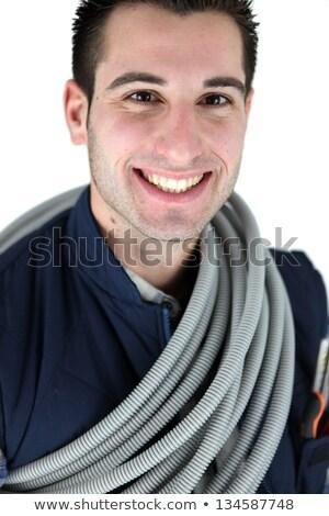 Tubulação sorrir azul trabalhador Foto stock © photography33
