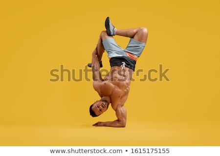 Sportsman is standing on hands for coordination stock photo © vetdoctor