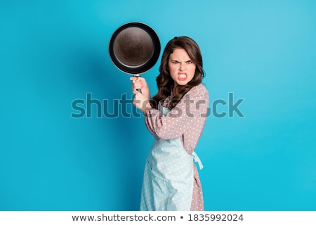 Brunette with frying pan stock photo © photography33