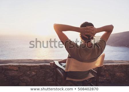 Fiatalember megnyugtató tengerpart nyári vakáció szabadság víz Stock fotó © juniart