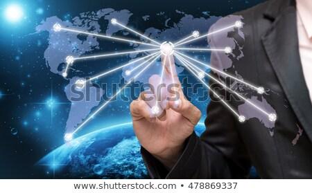 Człowiek wskazując świecie strony piłka czerwony Zdjęcia stock © photography33
