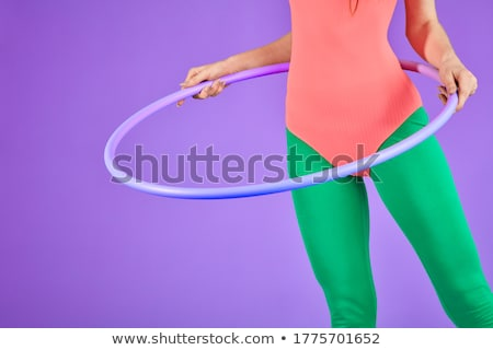 Pretty girl holding hula hoop Stock photo © Aikon
