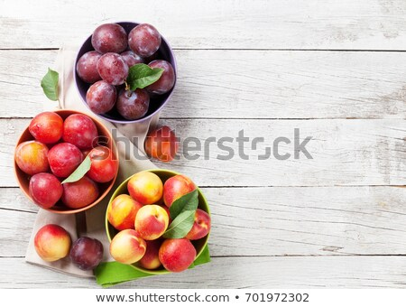 Plums and peaches Stock photo © elxeneize