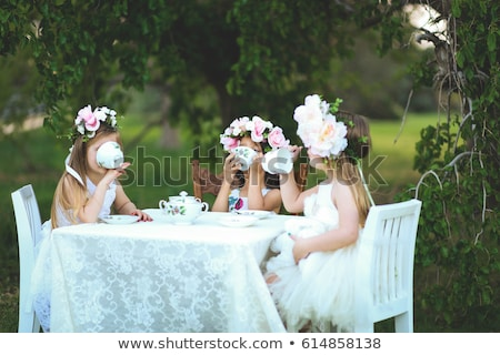 Mosolyog kislány tea buli ül fehér Stock fotó © ElinaManninen