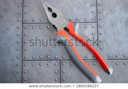 Riveter with red handles and one rivet stock photo © sarahdoow