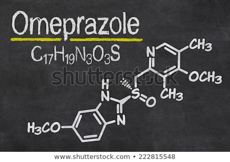 chemical formula of omeprazole on a blackboard Stock photo © Zerbor