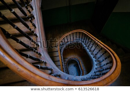 Wooden spiral stairs in ancient interior Stock photo © konradbak