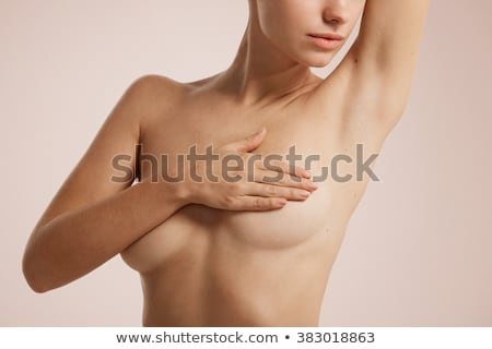 Manos pechos femenino cuerpo sólido oro Foto stock © michaklootwijk