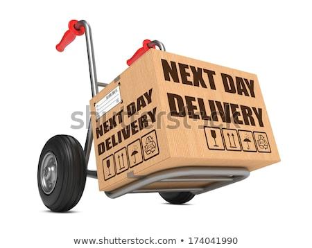 next day delivery   cardboard box on hand truck stock photo © tashatuvango