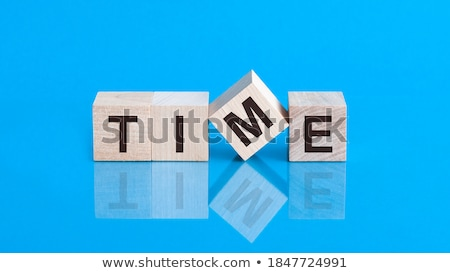 time for action in clock symbol in blue glass cubes Stock photo © marinini