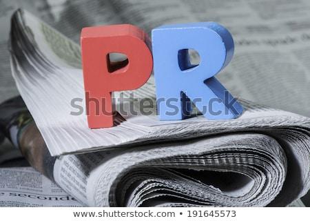 Palabra pr periódico cartas rojo Foto stock © deyangeorgiev