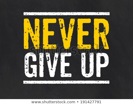 Blackboard with the text Never give up Stock photo © Zerbor