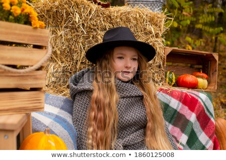 Beautiful girl with autumn leaves near the apple tree Stock photo © Nejron