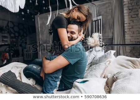 loving couple tenderly embracing stock photo © stryjek
