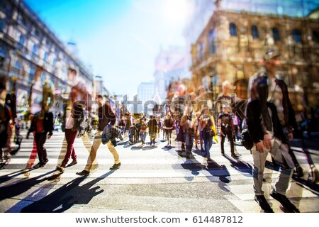 People and traffic cross the a busy city intersection Stock photo © Melpomene