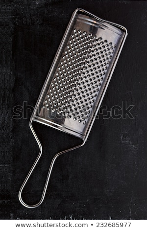 Stock photo: metal grater and tablecloth